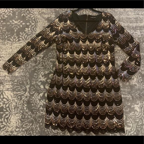 Scalloped, sequin, zipper dress.